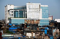 New constructed corporate office standing amidst slums of Behrampada in Bandra ; Bombay Mumbai ; Maharashtra ; India
