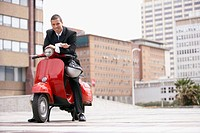Young Businessman on Red Scooter
