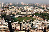 Aerial view of Bourbon stadium amidst the art deco buildings of Bombay Mumbai , Maharashtra , India