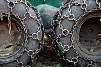Chains on the tire of a heavy forestry vehicle. Vaesternorrland, Sweden, Scandinavia, Europe