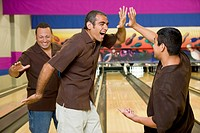 Three bowlers doing high_fives