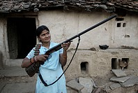 Woman with gun ; Chitrakoot ; Uttar Pradesh ; India