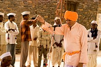 A narration given by man with music ; village Salunkwadi Ambajogai Beed ; Maharashtra ;  India