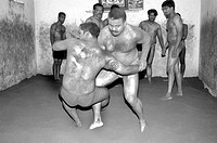 Men practicing Nada kushti  ; traditional Indian wrestling ; Mysore ; Karnataka ; India