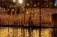Several hundreds of lamps or diyas lighted on ghat on eve of dev diwali god celebrating diwali on banks of holy Ganga river ; Varanasi ; Uttar Pradesh...