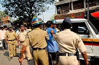 Police personnel charge lathi against a dalit rioter in Bhandup after the Dalit community resort to violent protests ; Bombay now Mumbai ; Maharashtra...