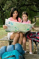 Mother and Daughter Examining Map