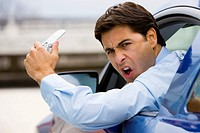 Road Rage Businessman with a Cell Phone