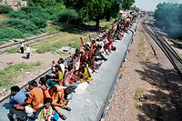 People sitting on roof of train , Jodhpur , Rajasthan , India