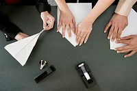 Co_workers Folding Paper Airplanes
