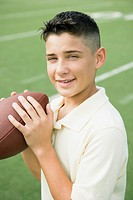 Boy Holding Football