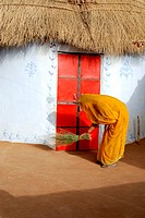 Woman cleaning hut , Bikaner , Rajasthan , India