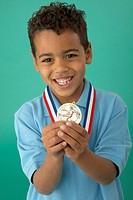 Boy Holding Soccer Medal