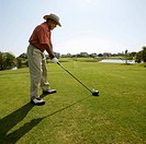 Middle_Aged Man Golfing