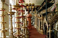 Shopping , brass oil lamps in Irinjalakuda , Kerala , India