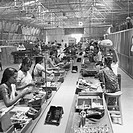 Workers at the assembly line , telephone factory , manufacturing of telephone instruments at Bangalore , Karnataka , India , year 1950 NO MR