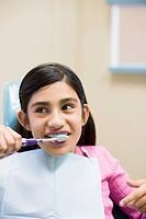 Dental Patient Brushing Her Teeth