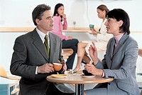 Businesspeople Talking Business in Cafeteria