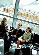 Businesspeople Talking at Airport Terminal