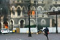 Smoke emits from Taj Mahal Hotel during terrorist attack ; Bombay Mumbai ; Maharashtra ; India 29-November-2008