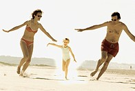 Girl Running with Parents on Beach