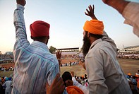 Sikh devotees encouraging players during friendly wrestling match , cultural events for 300th year´s celebrations of Consecration of perpetual Sikh Gu...