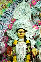 Goddess Lakshmi , sign of wealth , richness , prosperity , purity , generosity , embodiment of beauty at Durga puja festival , Kandivali , Bombay Mumb...