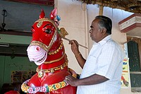 Man painting wooden horse vahanam at Karaikudi , Tamil Nadu , India NO MR