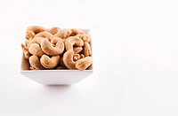 Bowl of Cashews on a White Background