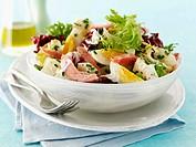 Potato salad with ham and eggs