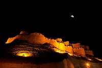 Nightview of half moon above fort of Jaisalmer , Rajasthan , India
