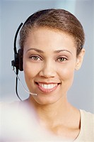 Portrait of a businesswoman using a headset in an office setting