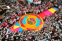 Grand colourful flower Rangoli made on road for immersion celebration of Lord Ganesh ; Sangli ; Maharashtra ; India