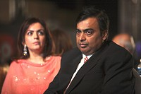 Mukesh Ambani with wife Neeta Ambani ; Chairman and Managing Director of Reliance Industries Limited RIL at CNBC-TV18 Indian Business Leader Award ; B...