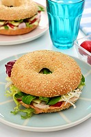 A chicken, lettuce and cheese bagel