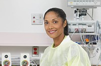 Portrait of a young female doctor posing for the camera in a hospital operating room