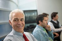 Portrait of a middle aged businessman posing for the camera during a meeting
