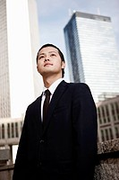 Tokyo Business Man in city surroundings