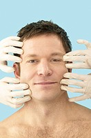 Plastic Surgeons Pulling Man´s Skin back from Face