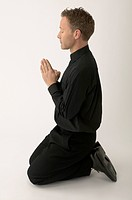 Priest Kneeling and Praying