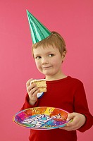 Little Boy Holding Birthday Cake Slice
