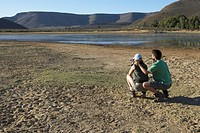 Couple Watching Animals at Water Hole