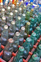 Empty glass soda bottles in crate