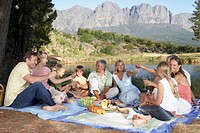 Family Eating Picnic by Lake