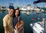Couple standing by their boat, Ventura Harbor Marina CA