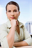 Businesswoman, leaning on elbow