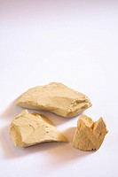 Herbal multani mitti stone on white background