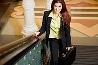 Businesswoman Ascending Staircase