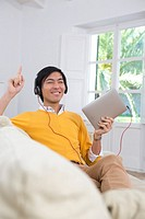 Young Asian man using his Tablet computer