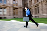 Businessman Running in Front of Building